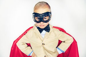 Studio shot of little hero in costume