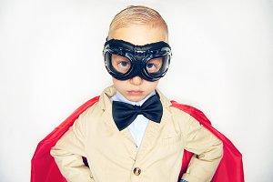 Shot of little boy in hero costume