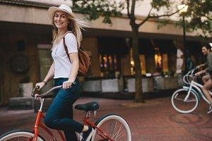 Beautiful woman riding bicycle