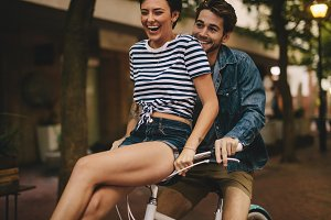 Couple having fun while riding