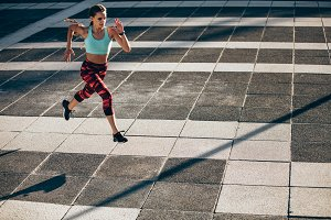 Woman doing morning workout in city