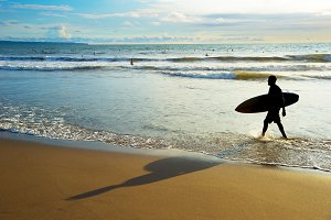 Surfer with surfboard beach
