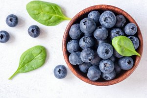 Fresh blueberries in bowl on white