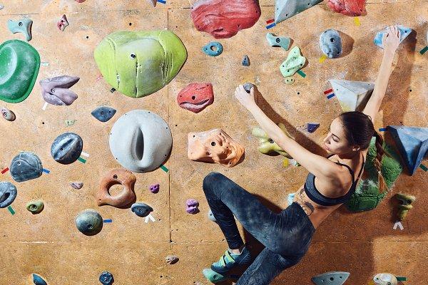 People Stock Photos: vitaliymateha photography - woman climber climbs indoors