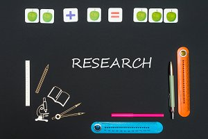 Above stationery supplies and text research on blackboard