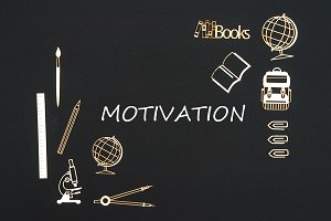 School supplies placed on black background with text motivation