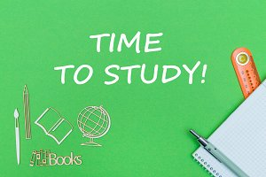 text time to study, school supplies wooden miniatures, notebook on green background