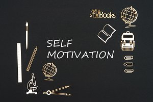 School supplies placed on black background with text self motivation