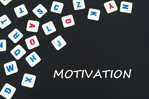 english colored square letters scattered on black background with text motivation