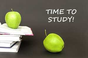 text time to study, two green apples, open books with concept