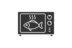 Cooking fish in microwave oven glyph icon