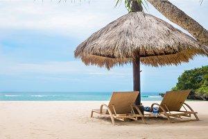 Sun loungers white tropical beach blue ocean shore