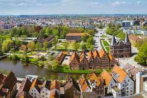 Panoramic view of the Holsten Gate in Luebeck, old bricks building and river. Aerial view
