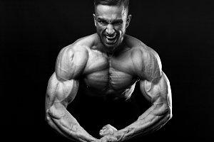 Scream of rage in the bodybuilder during training.