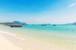 Andaman Sea with traditional longtail boats Rawai
