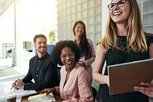 Laughing group of businesspeople working together in an office