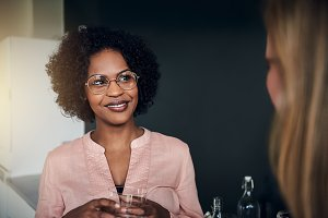 Smiling African businesswoman talking with a colleague at work