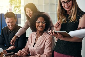 Smiling group of diverse businesspeople working in an office