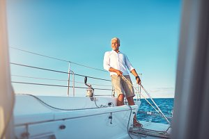 Mature man out for a sail on his boat