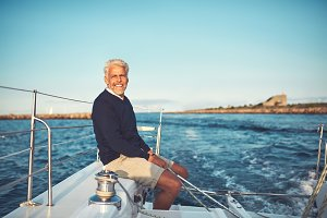 Mature man enjoying a day sailing on the ocean