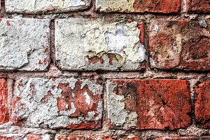 Old brick wall with white fragment