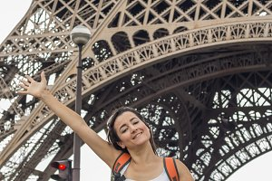 Smiling woman at Effiel Tower
