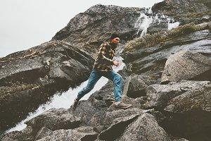 Running Man in waterfall mountains