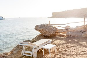 chaise longues on the beach