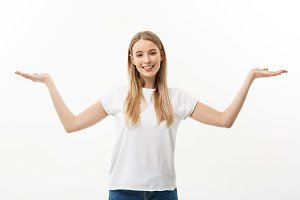 Portrait of young caucasian woman smiling and presenting two hands on side. Isolated on white background