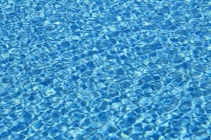 Rippled water texture in swimming pool