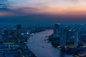 Aerial view of Bangkok cityscape at dusk