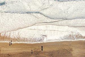Aerial view of ocean beach with people