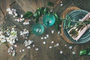 Flat-lay of Spring Easter Table setting with almond blossom flowers