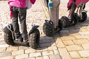 tourists riding in segway