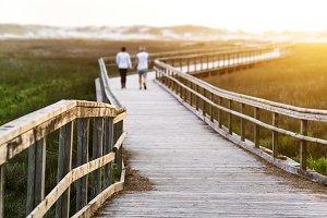 elderly senior couple in footbridge