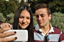 Young people watching their mobile p