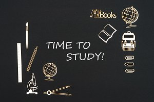 School supplies placed on black background with text time to study