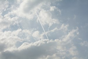 Cloudy Blue Sky with Chemtrail