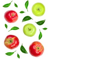 red and green apples decorated with green leaves isolated on white background with copy space for your text, top view