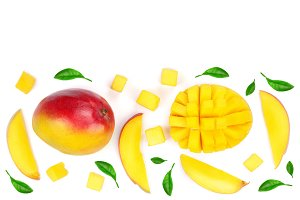 Mango fruit and slices decorated with leaves isolated on white background with copy space for your text. Top view