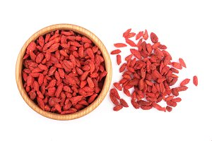 Dried goji berries in wooden bowl Isolated on white background