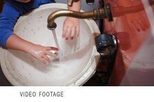 Child washing hands in vintage sink