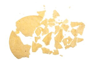 Potato chips crumbs and leftovers isolated over the white background