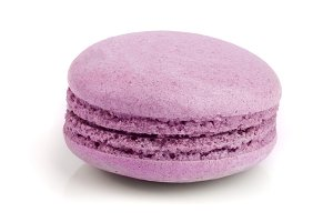 purple macaroon isolated on white background closeup