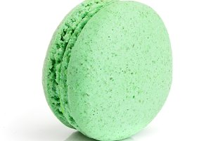 green macaroon isolated on white background closeup