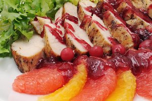 Sliced ​​baked fillet with cranberry
