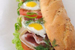 Big sandwich with ham, tomato