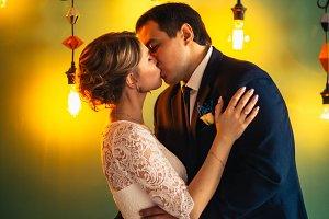 couple groom and bride in light studio