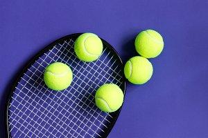 Tennis balls on black racket