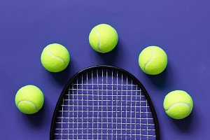 Yellow tennis balls and racket